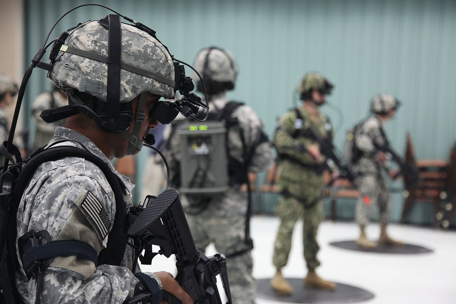 combat troop in gear with VR headsets